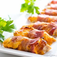 This easy baked bacon wrapped chicken tenders recipe needs just 3 common ingredients - chicken, bacon, and cheese! Ready in under 30 minutes.