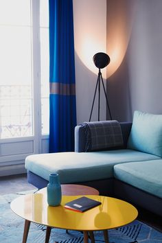 More Fabrics loves this interior by Charlotte Vinet, beautiful shades of blue tipped of with a cute yellow side table.