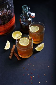 A simple, 7 ingredient hot toddy with chili-cinnamon infused maple simple syrup. Tart from lemon and sweet from the simple syrup and bourbon. A naturally sweetened, warming cocktail for the colder months. New Year's Drinks, Yummy Drinks, Fun Drinks, Refreshing Drinks, Alcoholic Drinks, Warm Cocktails, Minimalist Baker, Baker Recipes, Christmas Cocktails