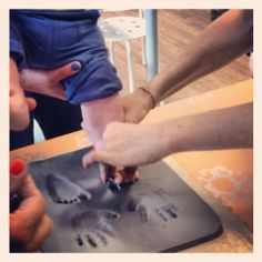 Creating hand and foot print impressions in clay at Art by You at Weirdgirl Creations Pottery Studio in Barrington RI