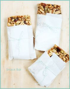 Snack Bars  Cereal, dates, cherries, pecans, pumpkin seeds, flax seeds, peanut butter, maple syrup, banana  You could substitute most of the ingredients for organic and raw to make them whole foods that actually feed your body!