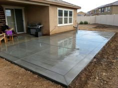 "Broom finish concrete patio slab with 12"" border bands."