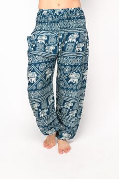 """Combining the balancing effect of the color turquoise with the intelligence and honor of the """"gentle giant,"""" these elephant harem pants are boho chic personified.   Incorporating three rows of changing patterns, these pants are a must-have for your next festival. Light and airy, they'll allow you to jump and move to the beat of your own drum, without feeling constrained or weighed down."""