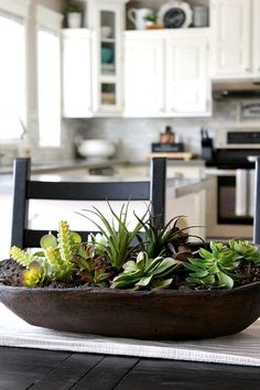 Create this easy dough bowl succulent planter in less than 10 minutes using real or faux succulents. Dining Room Centerpiece, Dining Room Table Centerpieces, Dining Table, Succulent Bowls, Succulent Centerpieces, Centerpiece Ideas, Kitchen Island Decor, Dough Bowl, Faux Succulents