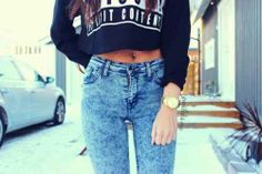 black long sleeve crop top with high waisted washed out jeans   belly button ring