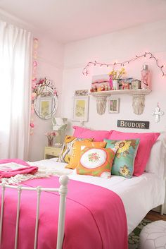 Love the bright pink bedding