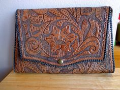 Vintage Tooled Leather Purse with Ornate Floral and Leaf Motif. via Etsy.