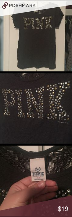 "PINK Gem T Shirt ""PINK Victoria's Secret"" charcoal t shirt. Back of t shirt is made of black lace that is see through. ""PINK"" label written with gold, silver, and rhinestone gems. Vintage shirt from about 10 years ago! Light to no wearing. PINK Victoria's Secret Tops Tees - Short Sleeve"