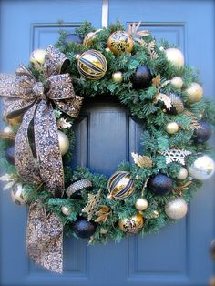 Black and Gold Christmas Wreath, Large Holiday Wreaths, Gold Christmas Wreaths, Large Christmas Wreaths by WreathsByRebeccaB on Etsy https://www.etsy.com/listing/203887955/black-and-gold-christmas-wreath-large