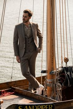 Woven in Donegal, our best-selling tweed suit has been given a Spring/Summer make-over with a  multi-tonal fawn base and single windowpane over-checks in royal blue & magenta. Formal Shirts For Men, Men Formal, Navy Trench Coat, Athletic Build, Tweed Suits, Checked Blazer, Fitted Suit, Donegal, Weekend Wear