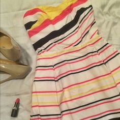 """Lilly Pulitzer strapless dress Yellow, blue, and pink striped strapless Lilly Pulitzer dress. Only worn a few times! Excellent condition - no tears or stains. It's a little on the short side. I'm 5'6"""" and I'm pictured wearing it. Let me know if you have questions! Lilly Pulitzer Dresses Strapless"""
