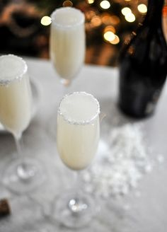 coconut bellinis, please. What you need: - 1 bottle of prosecco (maybe try moscato instead?) - 16 ounces of a coconut juice blend or coconut pureed nectar For the sugared rims: - 1/4 cup white sanding sugar - 2 tablespoons granulated sugar - 1 vanilla bean.