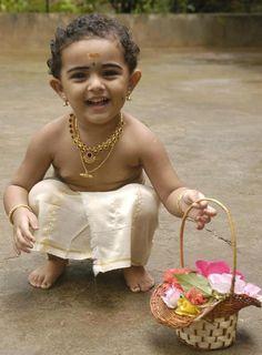 A little devotee offering prayers
