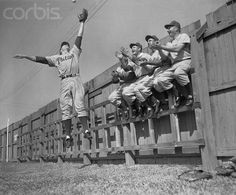 The Phillies Richie Ashburn leaps for the ball.
