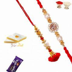 Send #Rakhi #Gifts to #india with #Divine Om Rakhi Bhaiya Bhabhi Rakhi Set from http://www.rakhistoreonline.com/rakhi/bhaiya-bhabhi-rakhi/divine-om-rakhi-bhaiya-bhabhi-rakhi-set.html