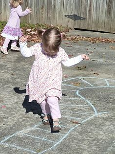Sidewalk chalk kid-created train tracks and other activities inspired by Freight Train @ Mommy and Me Book Club