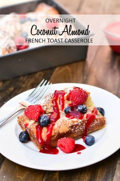 French toast casserole baked with a coconut almond puree and served with fresh berries and raspberry sauce #MothersDay