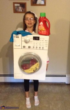 My daughter, Courtney is wearing a homemade washing machine Halloween costume. Simply used a box with a cut out for her head and arms. Painted it white and used my own washing machine as the model. A few things purchased from the dollar store including. Boxing Halloween Costume, Homemade Halloween Costumes, Halloween Costume Contest, Halloween Costumes For Girls, Halloween Fun, Zombie Costumes, Modern Halloween, Halloween Couples, Family Costumes