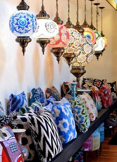 Turkish textiles in pillows and lanterns add bohemian fun to the home.