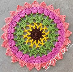 A Sunflower Mandala (or Doily) which can be made up in the yarn of you choice (remember to adjust your hook according to your yarn weight). A DK (8ply) cotton with a 4.50mm hook produces a cloth of approximately 30cm in diameter