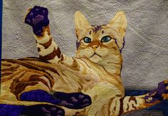 """""""His Arms Open Wide"""" by Teresa Rives. 2014 Quilt Colorado Show, Meritorious Quilting award. Photo by So Fun To Quilt."""