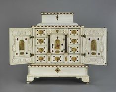 Court ivory cabinet, Augsburg, around 1650, circle of Melchior Baumgartner (1621-1686). The drawer fronts and folding doors of the cabinet are adorned with 19 enamel paintings which image the complete passion of Christ.