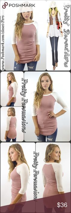 """NWT Ivory Pink Ribbed Raglan Tunic Top NWT Ivory Pink Ribbed Raglan Top  Available in sizes S, M, L Measurements taken from a small  Length: 32"""" Bust: 26"""" Waist: 24"""" Measurements taken unstretched  Features  • soft, breathable material with stretch • pretty ivory & blush pink rose coloring  • raglan style • ribbed • round neckline  • 3/4 sleeves  Rayon, Spandex blend  • Pretty Persuasions BASICS Line •  Fair offers welcome-Plz use offer option  Bundle discounts available  No pp or trades…"""