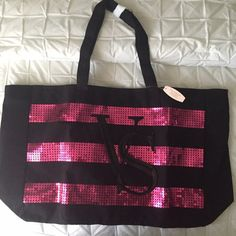 Listing! NWT Victoria's Secret Striped Lg Tote Victoria's Secret black large tote with pink sequin stripes and VS on front. Approximately 24 inches across and 14 inches long. Victoria's Secret Bags Totes