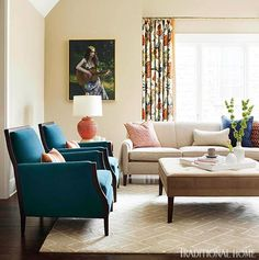 Love the colors, especially the teal chairs! Fabric is Gilmore Teal by Mitchell Gold + Bob Williams.