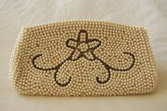 1950s pearl beaded clutch with flower inlay. $28.00, via JulsGems on Etsy