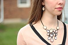 peach and black statement necklace