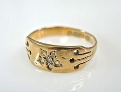 One 15 karat yellow gold Victorian ring. Six rose cut diamonds (0.04 carats: SI clarity: H-I colour).