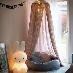 kid's reading corner with Miffy lamp. This looks so cozy I want to curl up in there with a hot chocolate and good book myself!