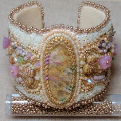 Trianon Bead Embroidered Cuff by PeapodBeads on Etsy, $163.26 - Bead embroidery has been mounted on a lightweight adjustable aluminium cuff blank, fully lined in cream ultrasuede (synthetic)