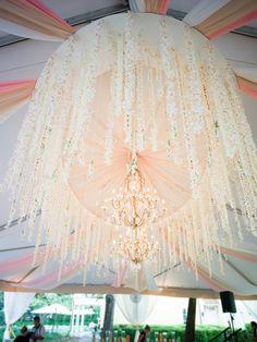 chandelier with flower garlands, photo by Virgil Bunao http://ruffledblog.com/william-aiken-house-wedding #weddingideas #lighting