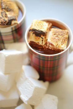 Homemade hot chocolate and marshmallows in tartan mugs.