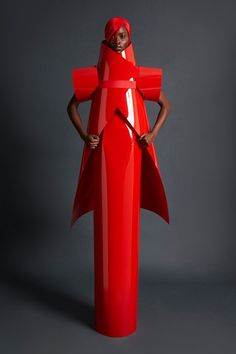 Gareth Pugh's innovative collections are always hotly anticipated on the LFW schedule, and the Sunderland-born designer did not disappoint. He curved heavy-looking materials into tubes, wraps and cage-like forms, resulting in red and black garments that look more like armour than clothes.