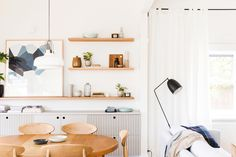 Light and bright. The whitest of whites, the palest of woods. Here are a few projects from Melb...