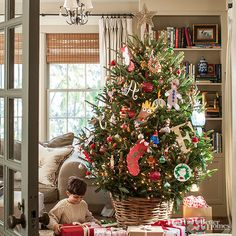 For a tree that's special to your family and one-of-a-kind, decorate with handmade treasures and letters representing each relative. Art projects, sentimental ornaments, and lots of fun color make this tree unique. Want an unexpected touch? Try placing the tree in a rustic basket instead of opting for the usual tree skirt.