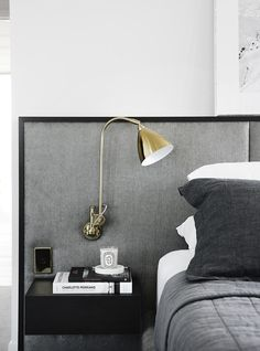 Renovation: the overhaul of an art-loving, empty-nester& Melbourne apartment: Lighting plays an important role in this home, with interesting and intricate detailing — including this exposed lamp attached to the bedroom headboard. Hollywood Vintage, Hollywood Glamour, Hollywood Regency, Stylish Bedroom, Modern Bedroom, Modern Wall, Home Bedroom, Bedroom Decor, Bedroom Ideas