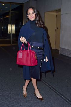 Head to toe in navy, Meghan wears a skirt by Veronica Beard with popping pink Marc Jacobs bag at the Today Show, March 2016