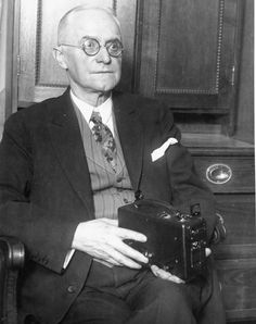 George Eastman holding one of his cameras