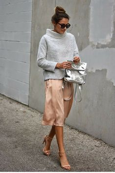 sneakers and pearls, street style, pair a soft skirt with a chunky knit, silver backpack, trending now.jpg