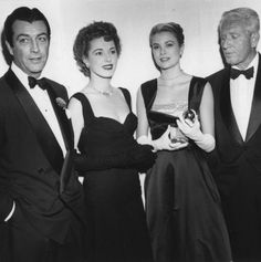 Robert Taylor, Eleanor Parker, Grace Kelly, and Spencer Tracy