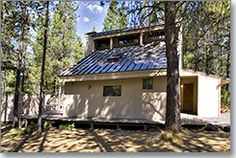 Cute Sunriver cabin within a short distance of the Village. 2 Bedrooms/2 baths, with newer hot tub. Cozy living space with loft upstairs for kids to gather. Day bed with trundle and queens in each bedroom. Spiral staircase to loft and 2nd bedroom.