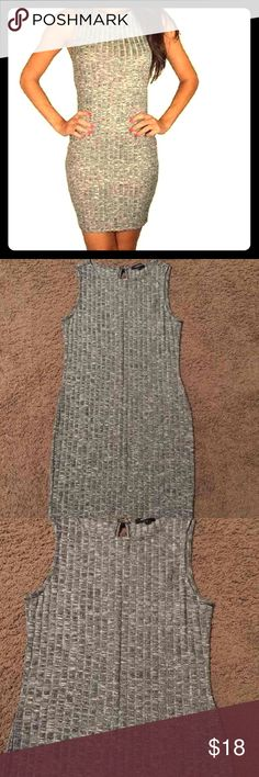 Light Gray Dress Cute light gray figure fitting dress. This beautiful dress is in size Large in women. Great for going out in. Dresses Mini