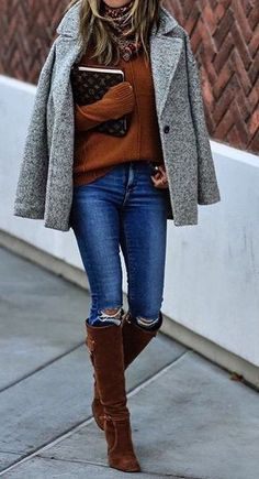 Grey peacoat, rust colored sweater, skinny jeans, brown suede over-the-knee boots