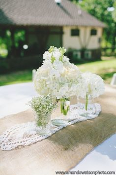 White Stock, Hydrangea, and Baby's Breath Centerpieces in Mason Jars - The French Bouquet - Amanda Watson Photography