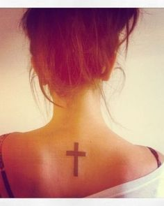 Cross tattoo  If my first tattoo would not   have hurt so much... I might think,about this!  -She