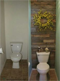 Add wood planks to the wall behind the toilet in a guest bath or half bath. -- Amazing! If not wood, could do tile, wallpaper, or a painted accent wall.